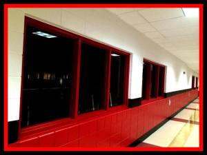 Hallway at Homestead outside the athletic facilities. Floors polished and walls repainted. Football started a month ago, though, so I don't think it smells as good as it looks.
