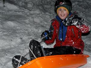 Should you let your kids sled in the backyard when the bottom of the hill is in the woods?  Sure, as long as they wear a helmet.